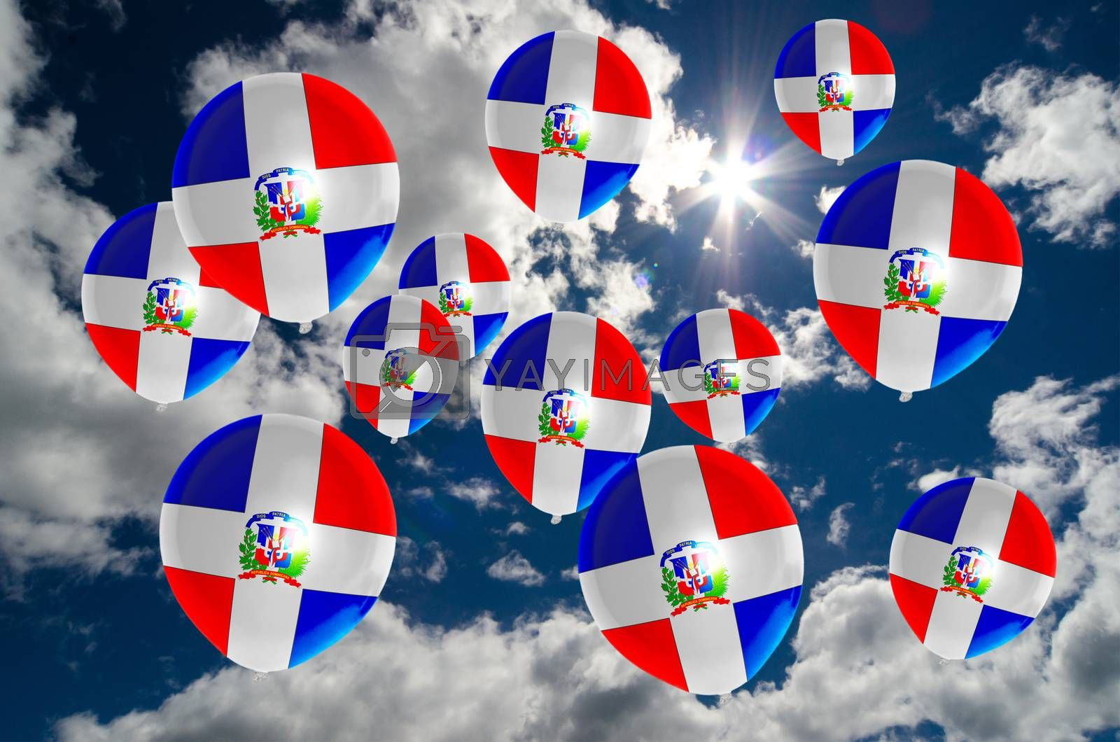 many ballons in colors of dominican flag flying on sky