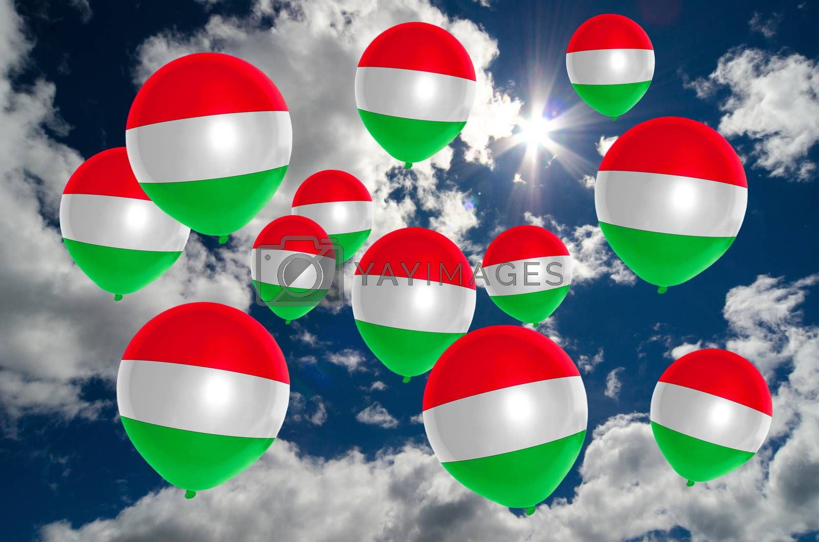 many ballons in colors of hungary flag flying on sky