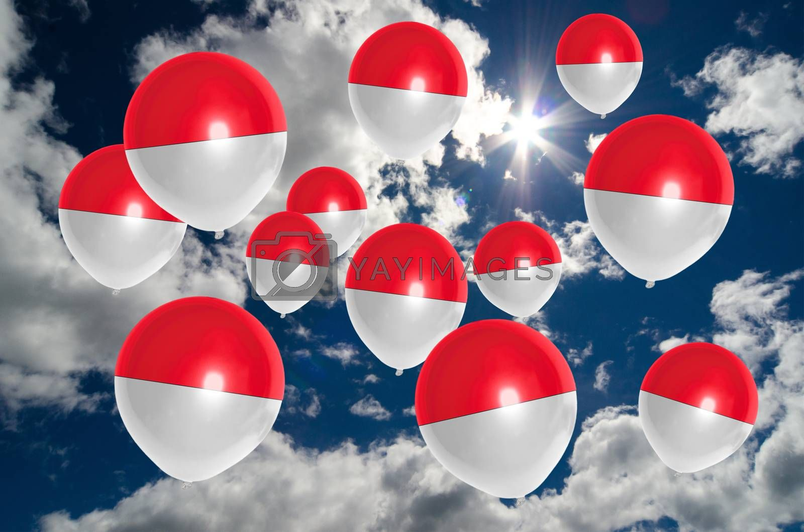 many ballons in colors of indonesia flag flying on sky