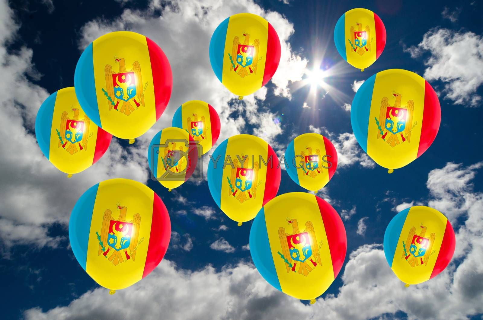 many ballons in colors of moldova flag flying on sky