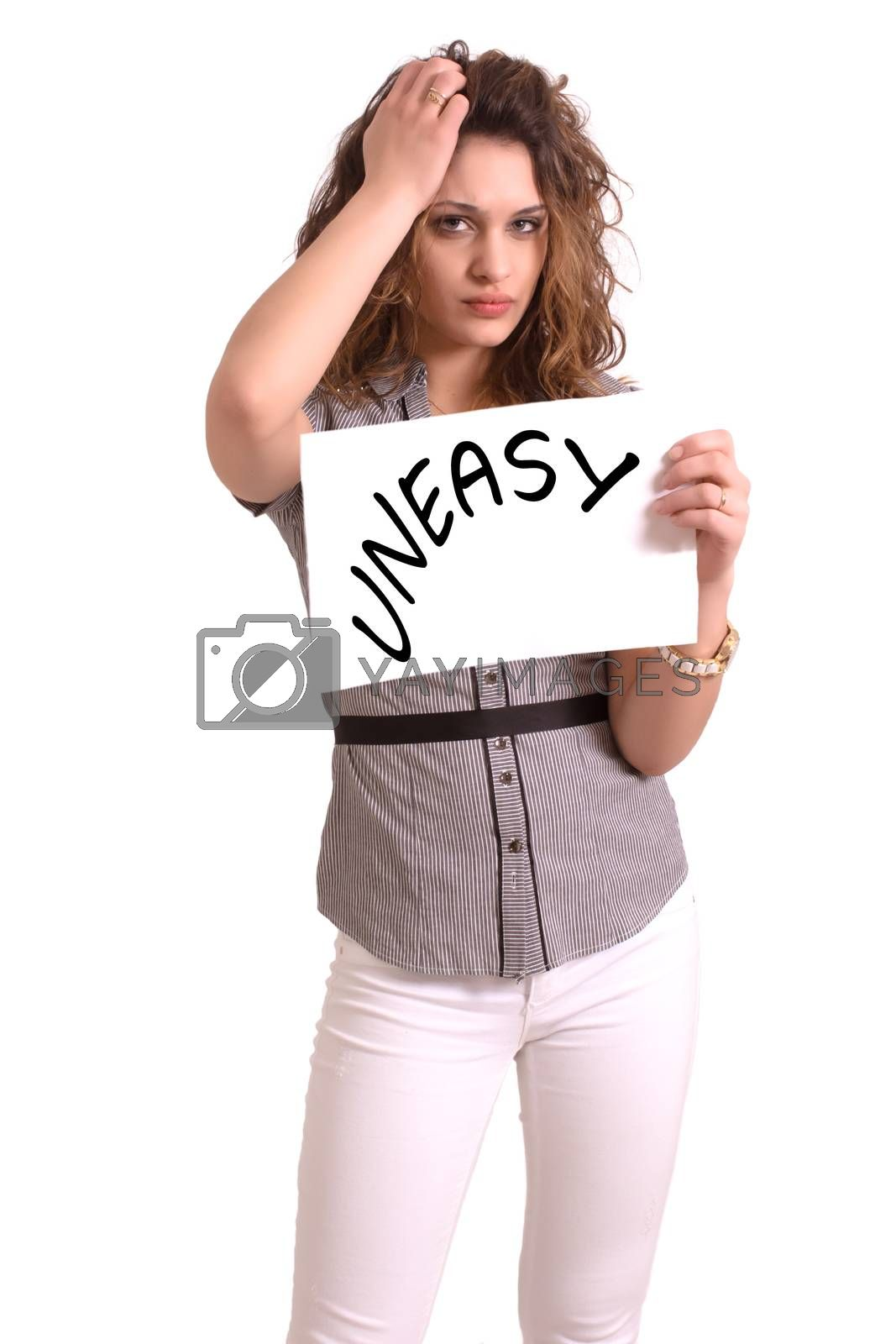 Young attractive woman holding paper with Uneasy text on white background