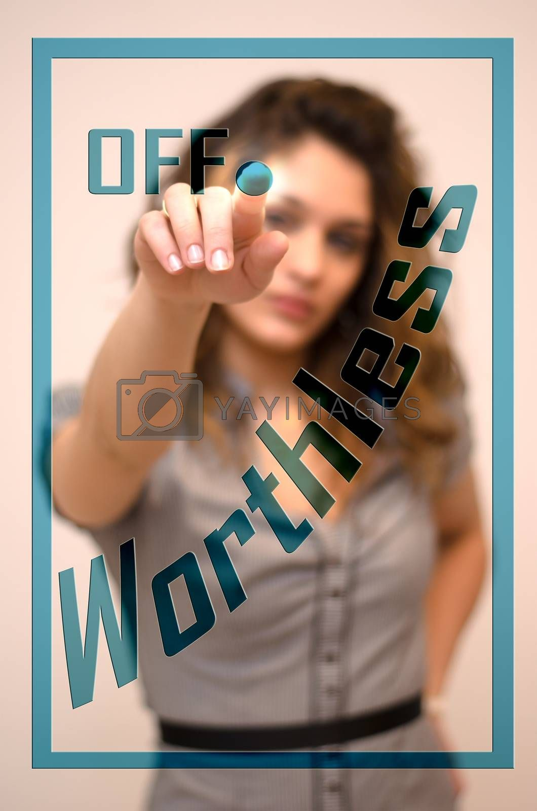 Royalty free image of woman turning off Worthless on panel by vepar5
