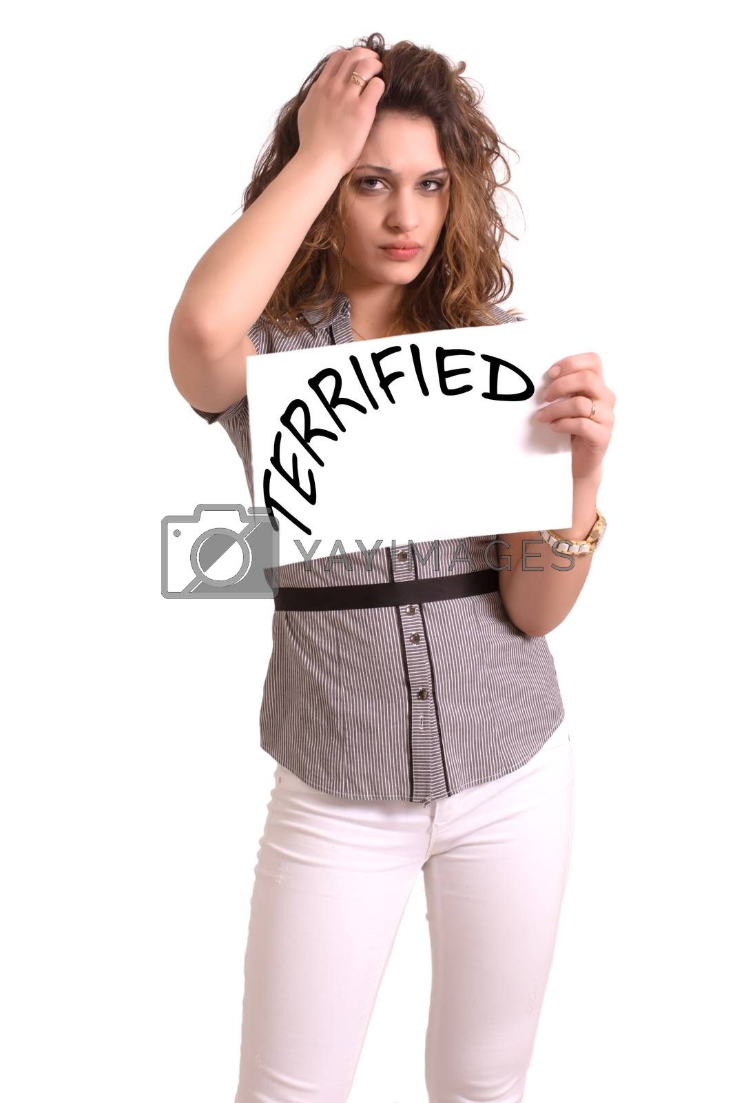 Royalty free image of uncomfortable woman holding paper with Terrified text by vepar5