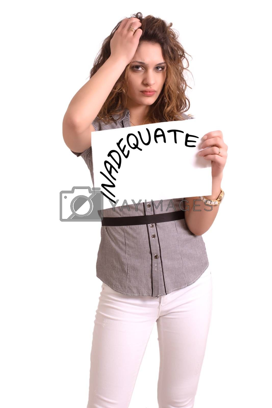 Young attractive woman holding paper with Inadequate text on white background