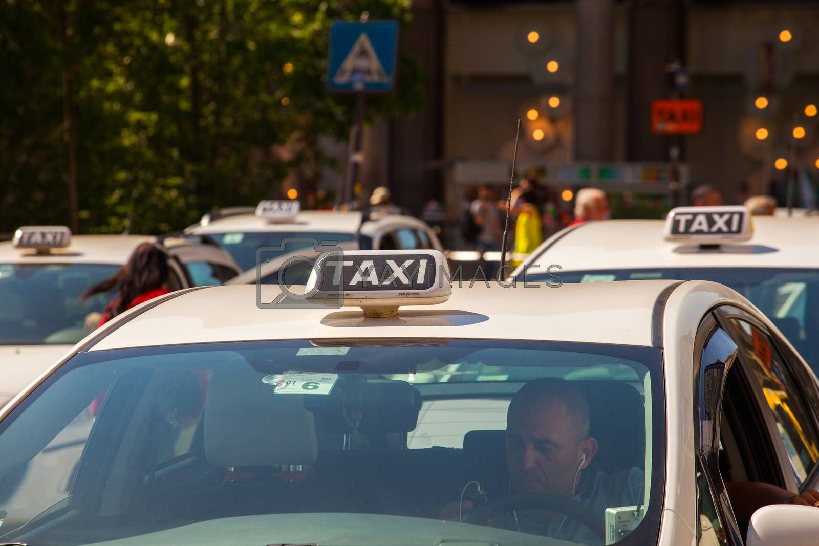 MILAN, ITALY - MAY, 15: Taxi parking in Milan on May 15, 2015