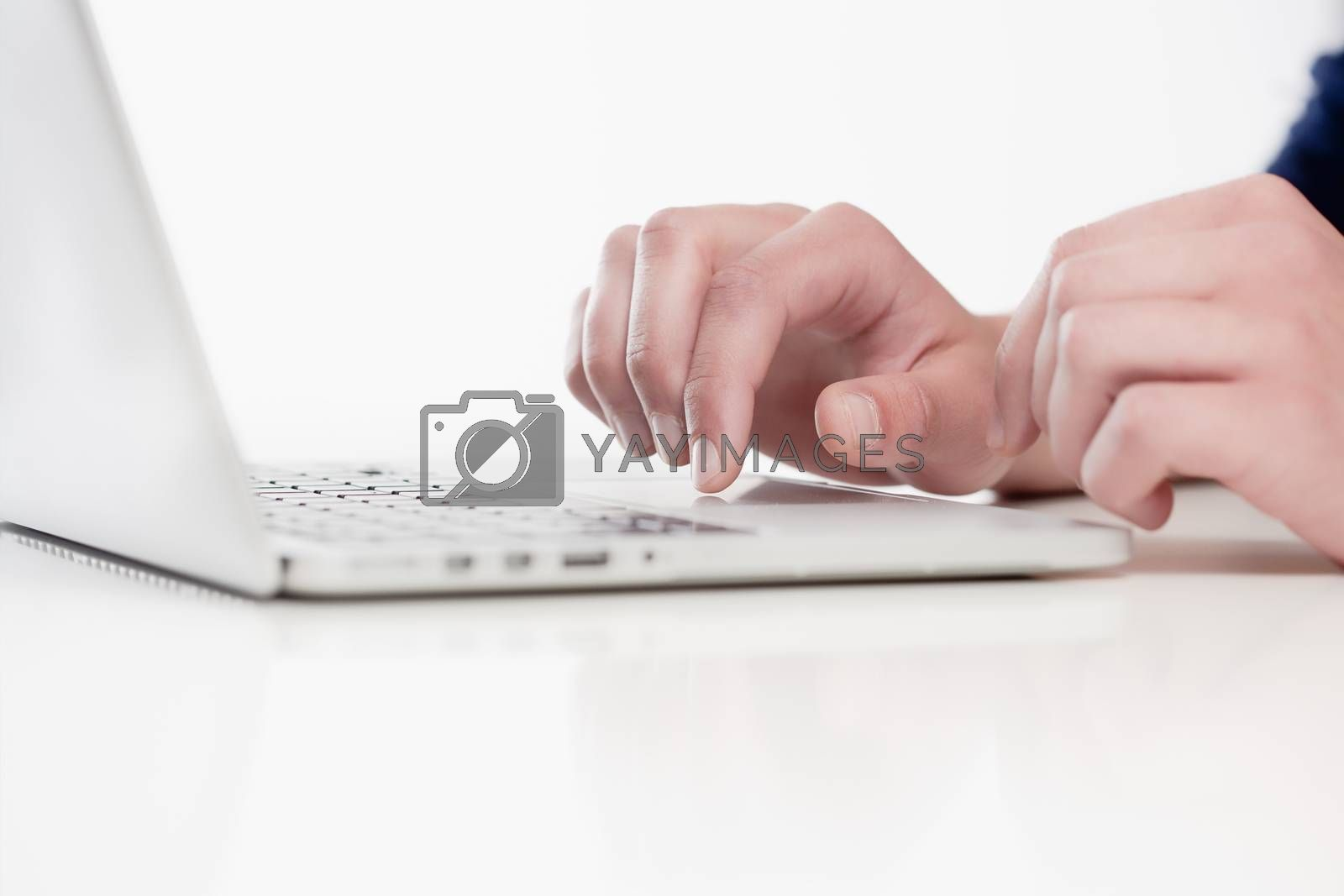 Royalty free image of Closeup of Fingers Using Keyboard by courtyardpix