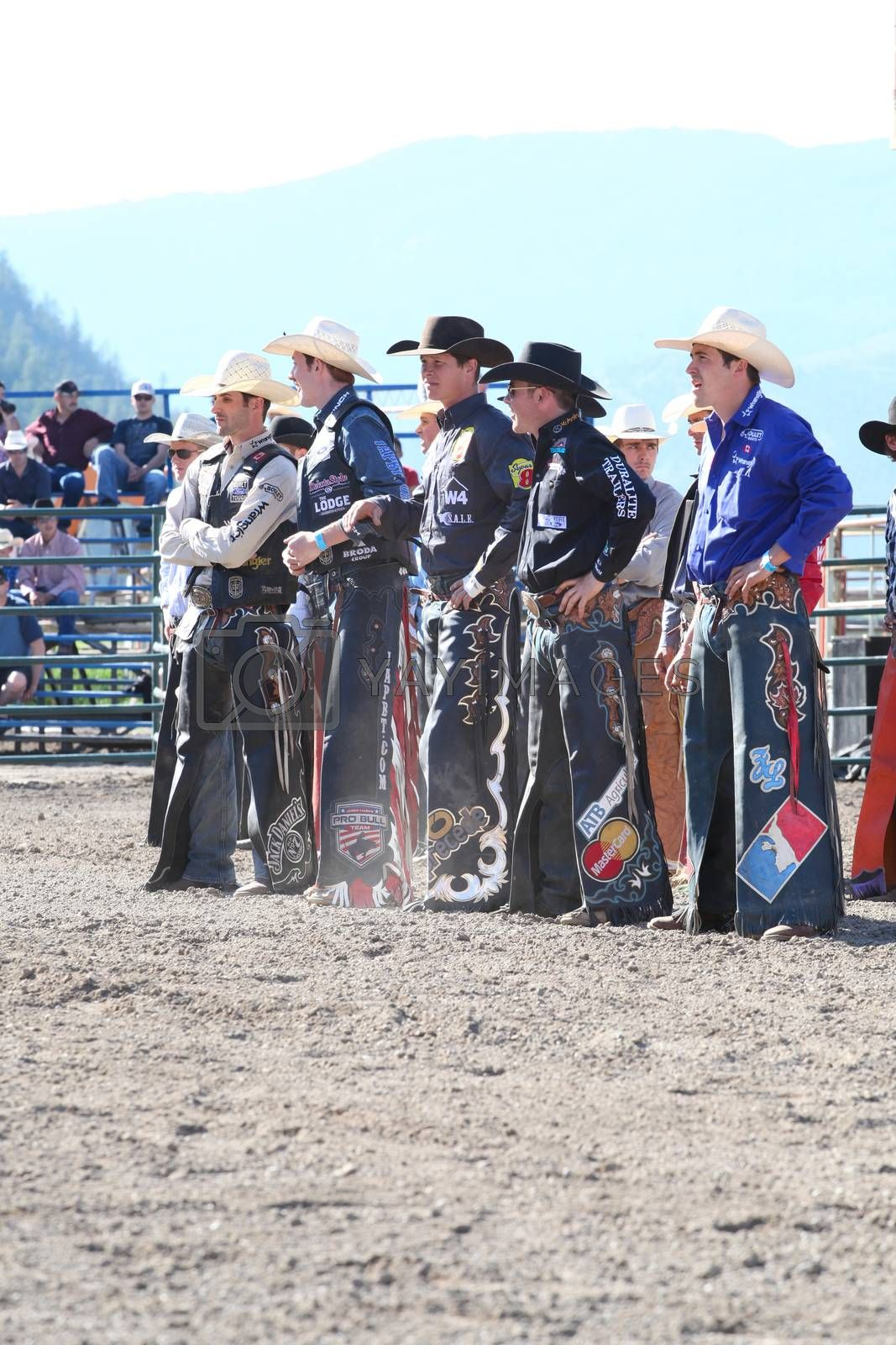 MERRITT, B.C. CANADA - May 30, 2015: Bull riders riding in the opening ceremony of The 3rd Annual Ty Pozzobon Invitational PBR Event.