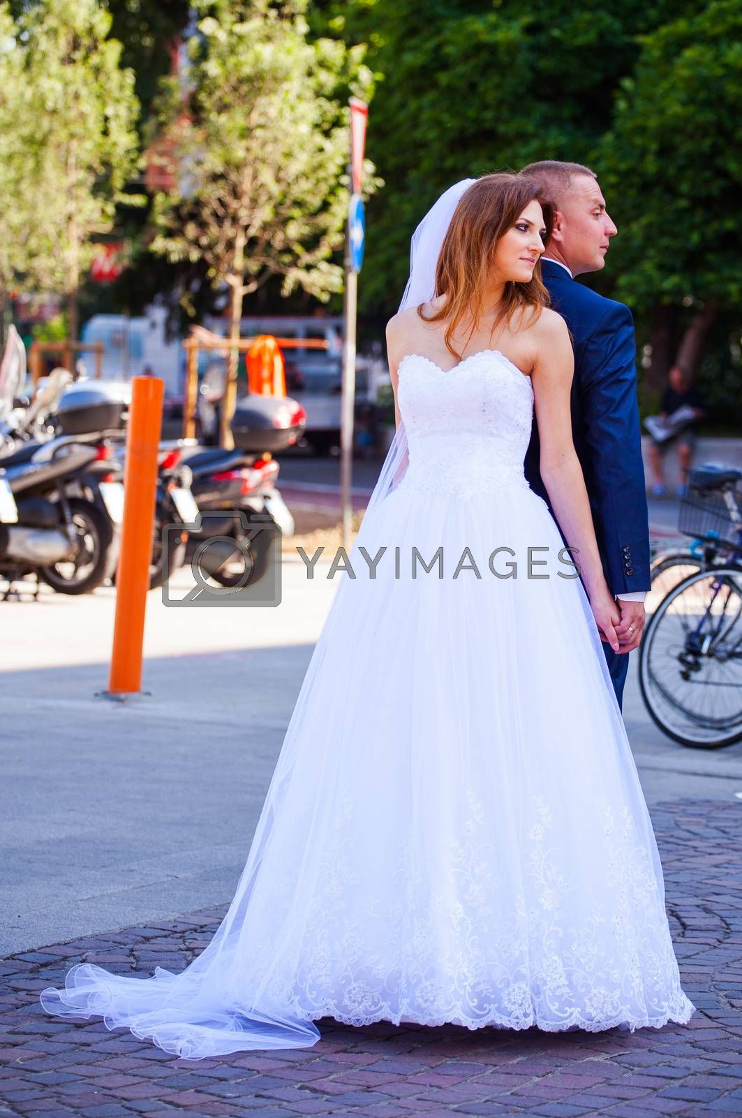 MILAN, ITALY - MAY, 15: Bride and groom posing for photo shooting on May 15, 2015