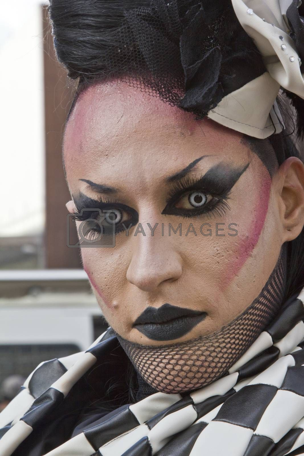 SAO PAULO, BRAZIL - June 7, 2015: An unidentified Drag Queen dressed in traditional costume celebrating lesbian, gay, bisexual, and transgender culture in the 19� Pride Parade Sao Paulo.