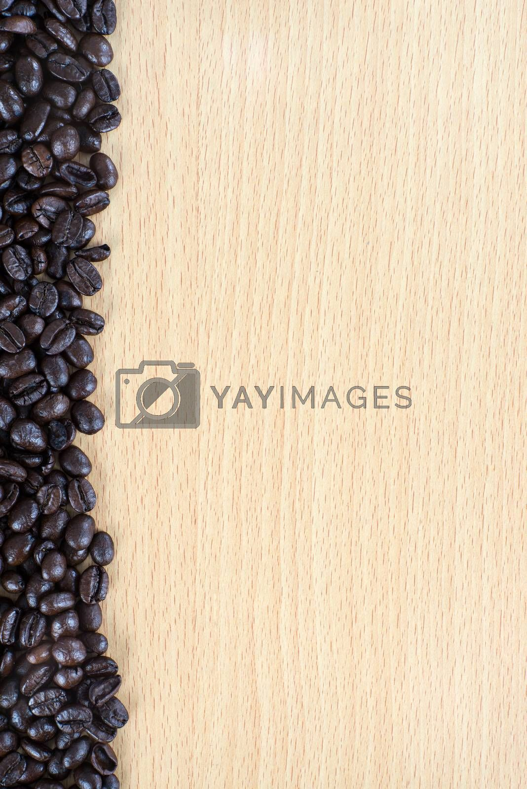 Royalty free image of Coffee bean on wood background by iamway