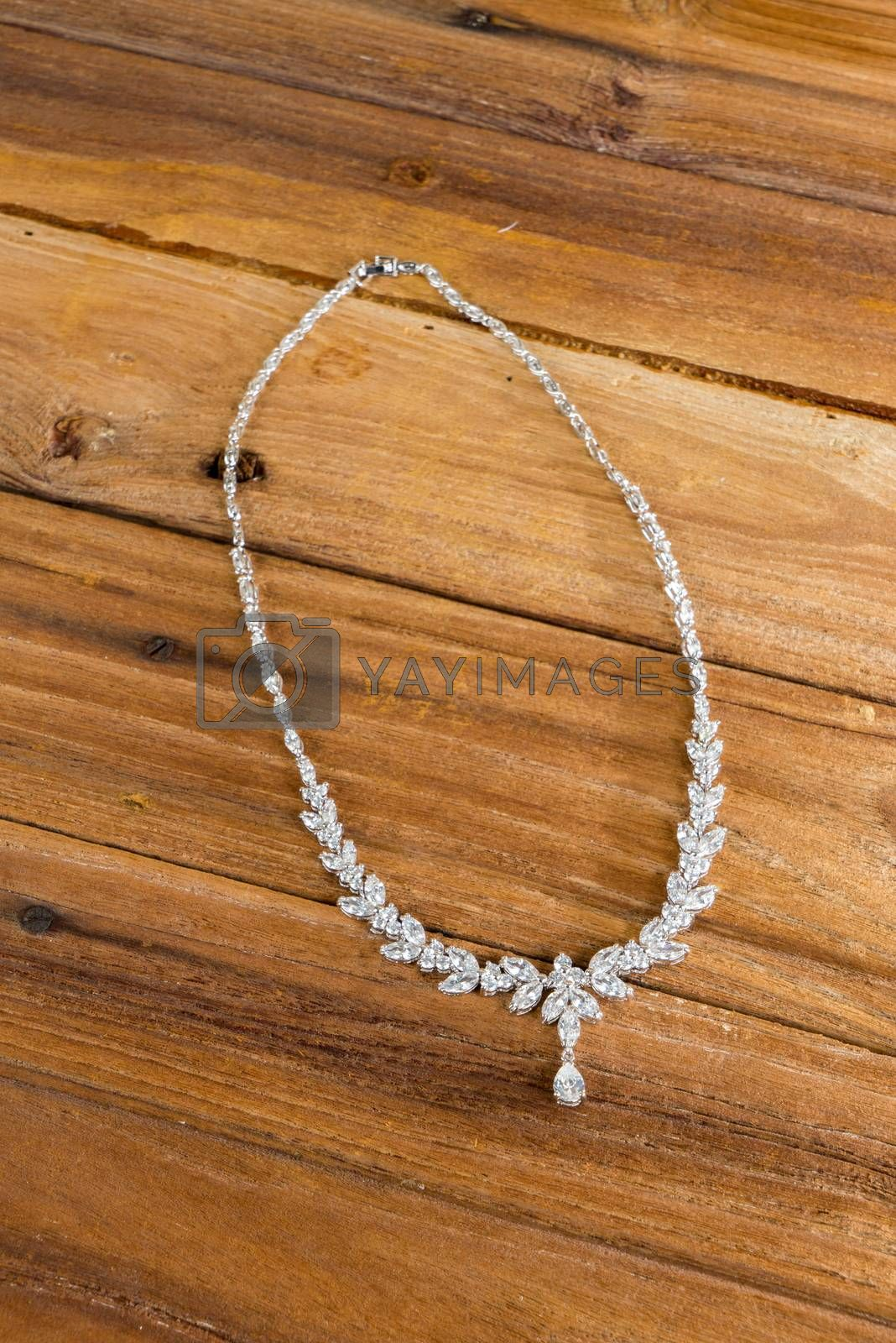 Royalty free image of Diamond necklace on wooden background by iamway