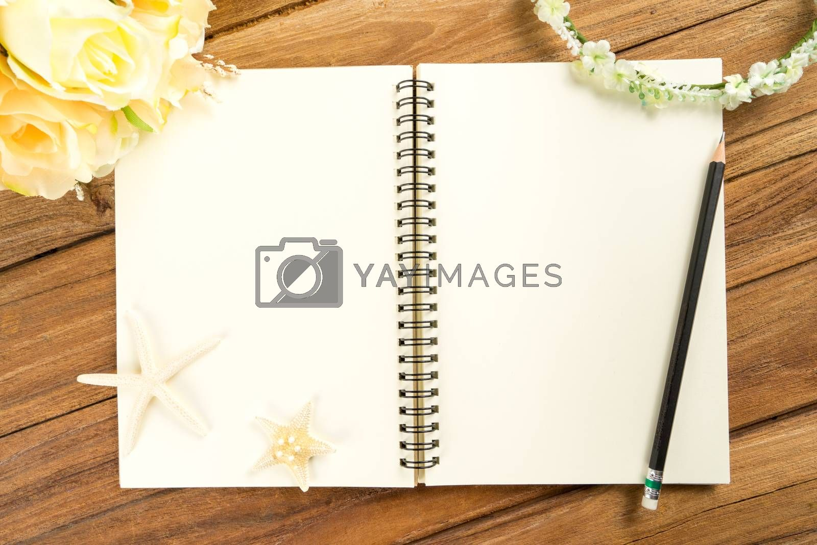 Royalty free image of Planning paper with pen, rose headband, tiara, bouquet, starfish by iamway