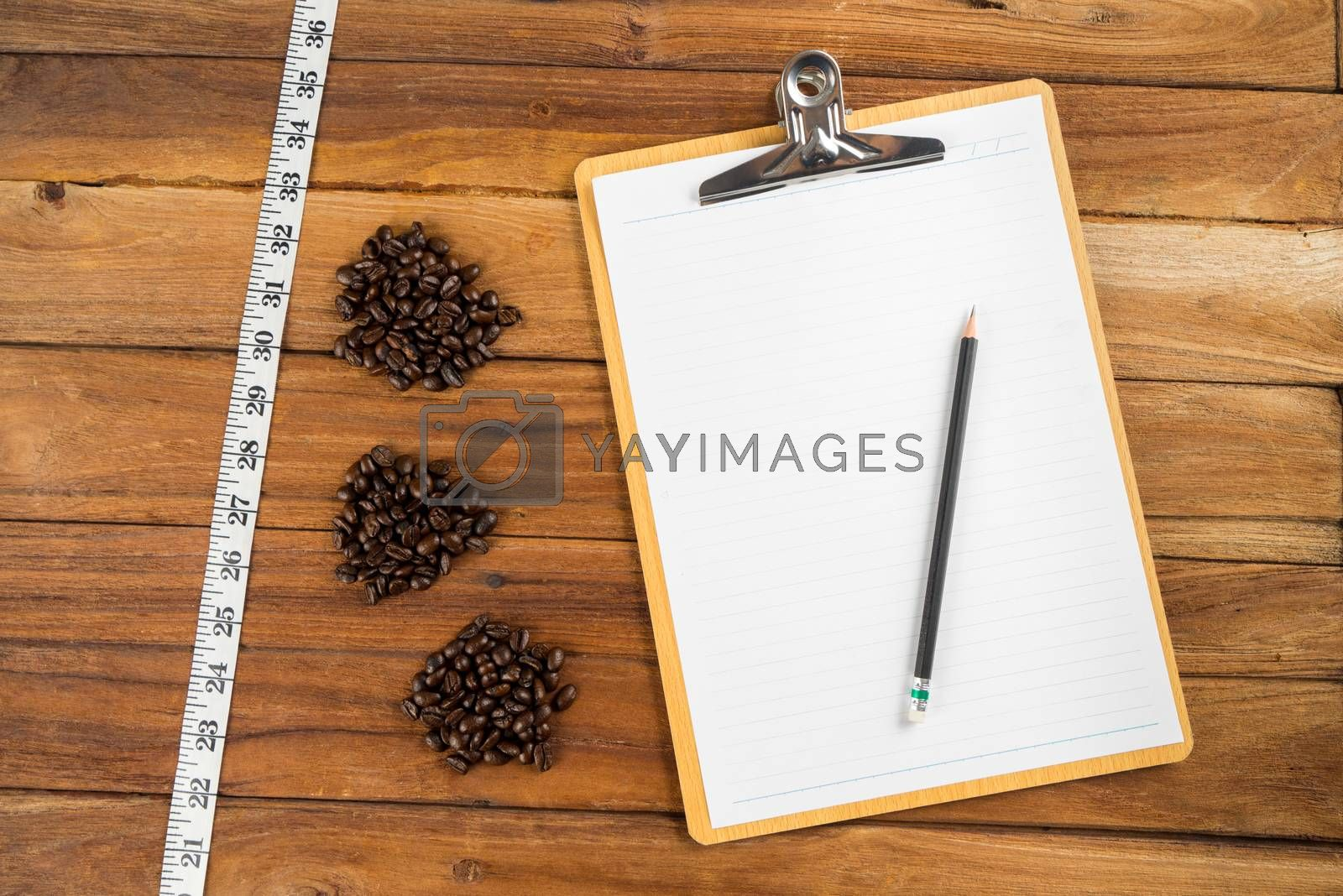Royalty free image of Wooden Clipboard attach planning paper with pencil beside coffee by iamway