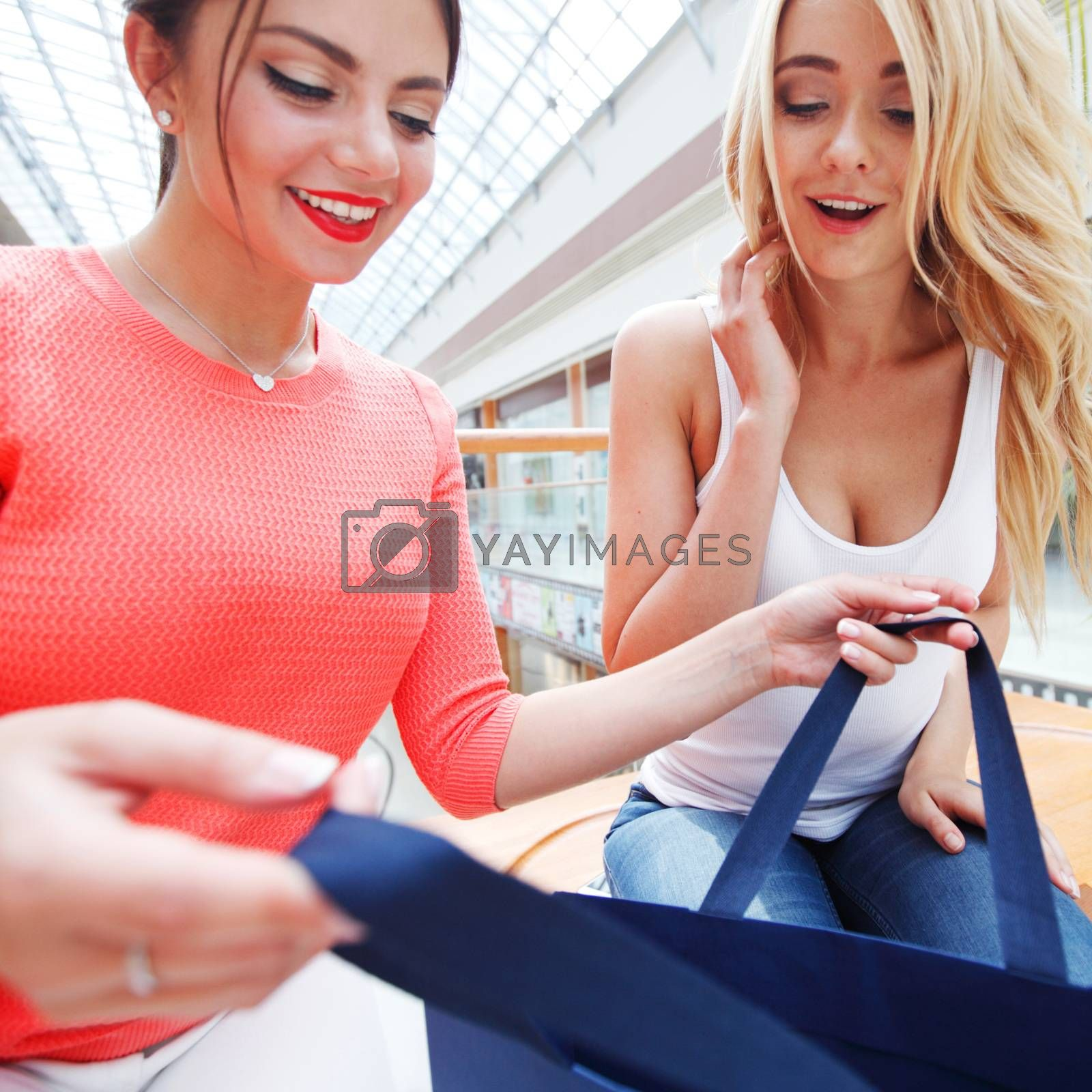 Women looking into shopping bag by ALotOfPeople