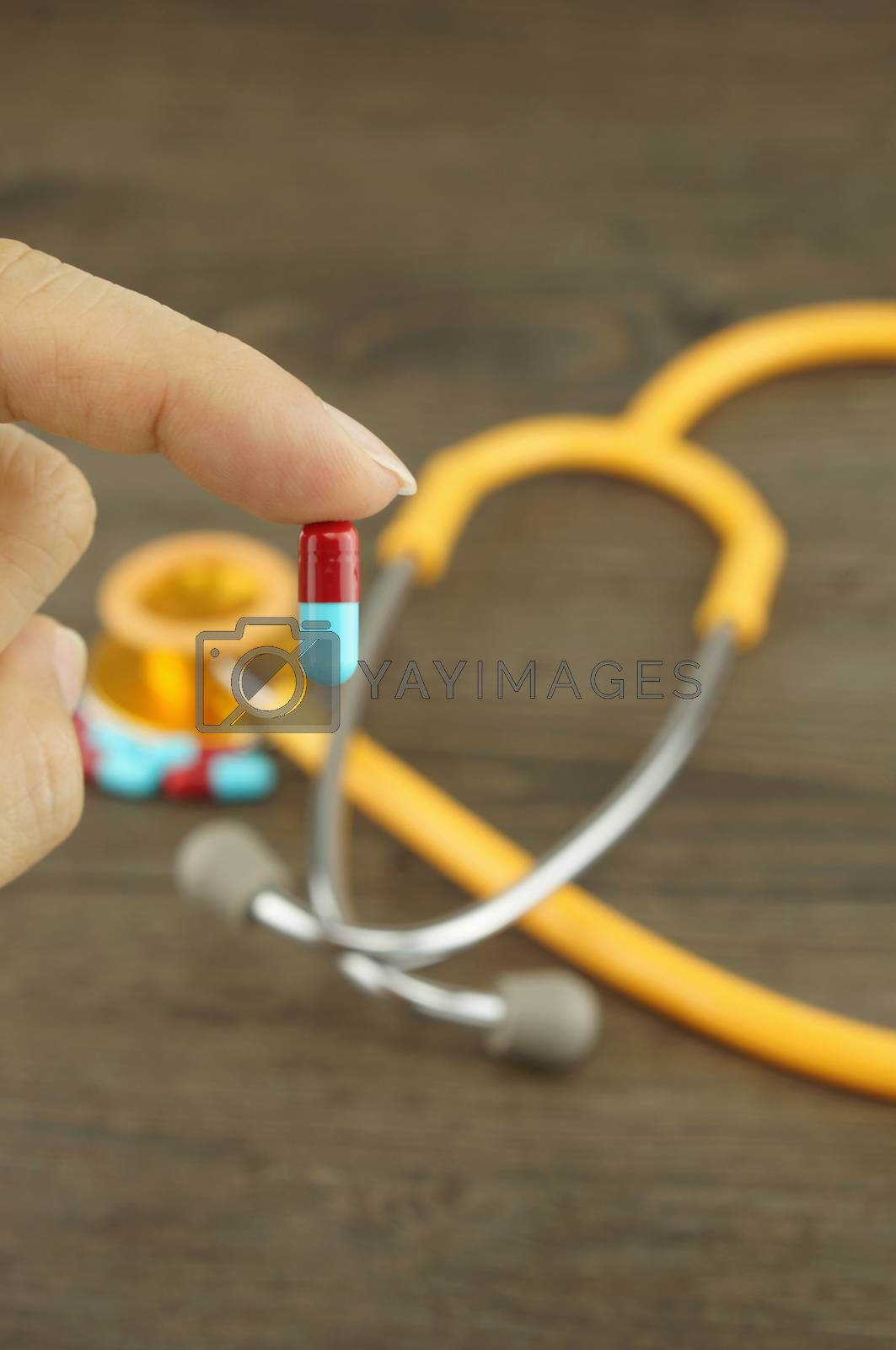 Royalty free image of Holding medicine by ninun