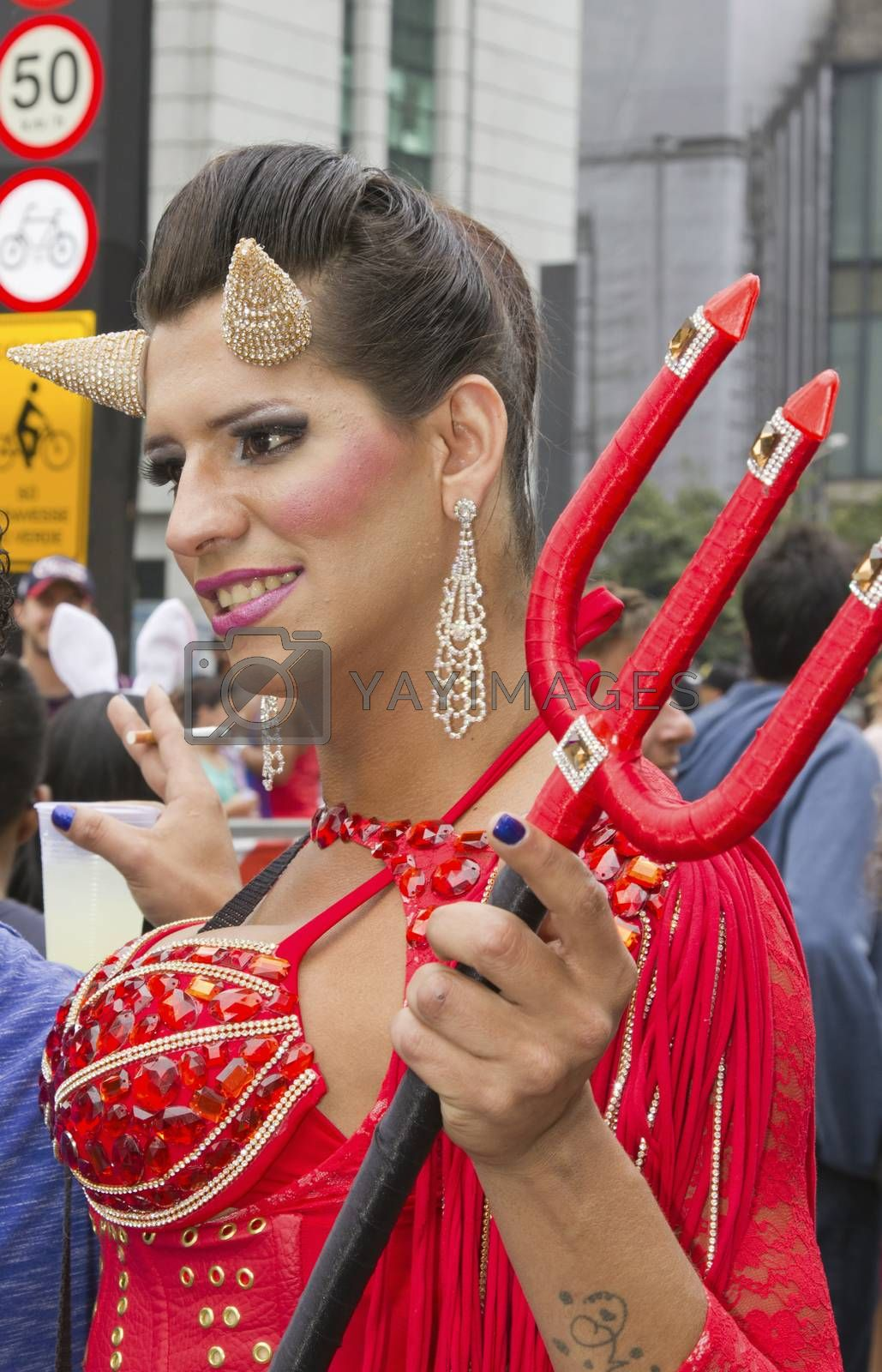 SAO PAULO, BRAZIL - June 7, 2015: An unidentified person  wearing costume and celebrating lesbian, gay, bisexual, and transgender culture in the 19º Pride Parade Sao Paulo.