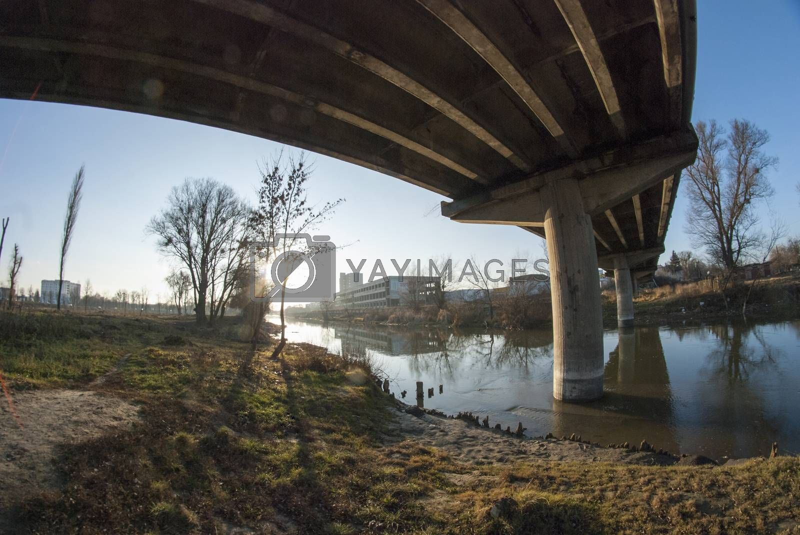 Royalty free image of Bridge on the river washing by Morfey713