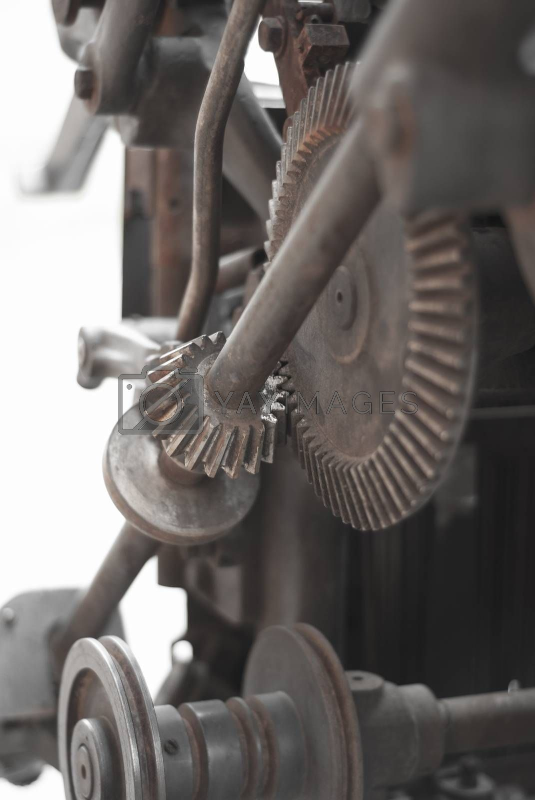 Royalty free image of Old rusty gears printing press by Morfey713