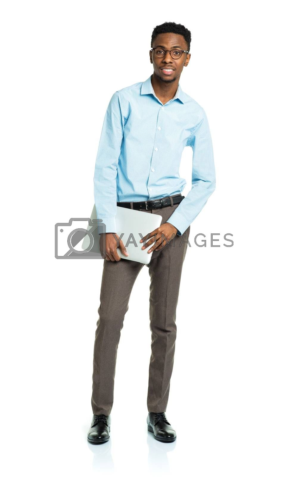 Royalty free image of Happy african american college student with laptop standing on w by vlad_star