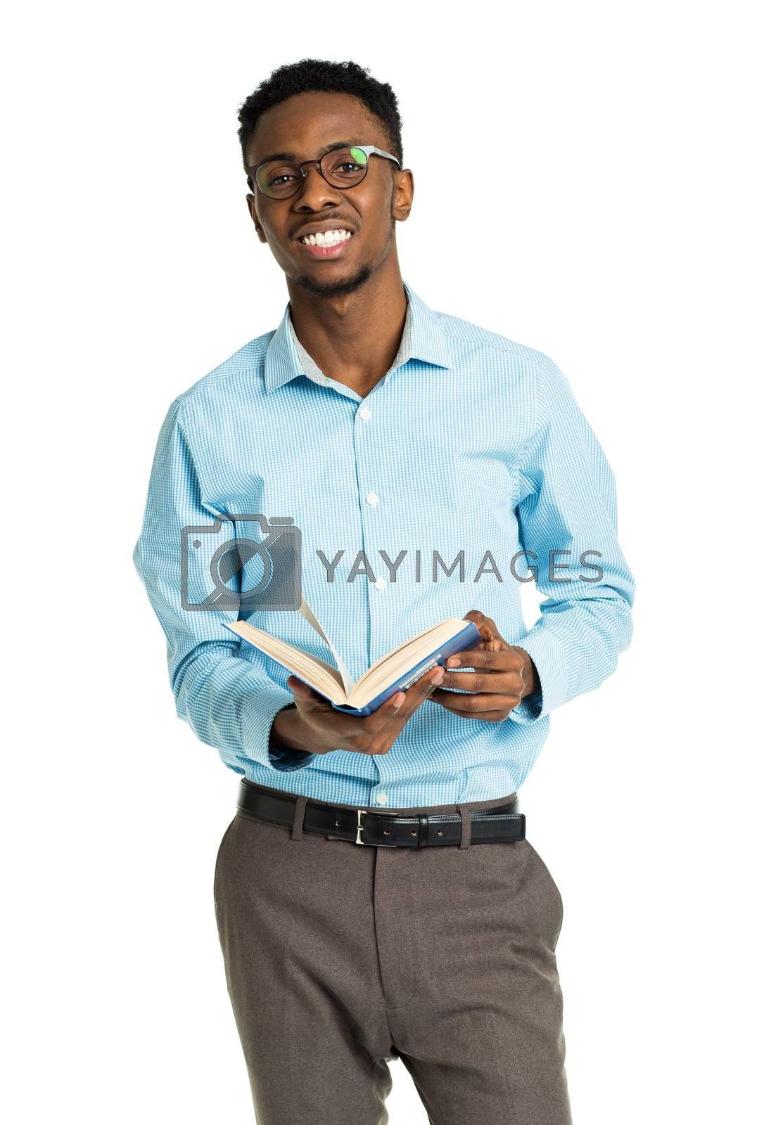 Royalty free image of Happy african american college student with books and bottle of  by vlad_star