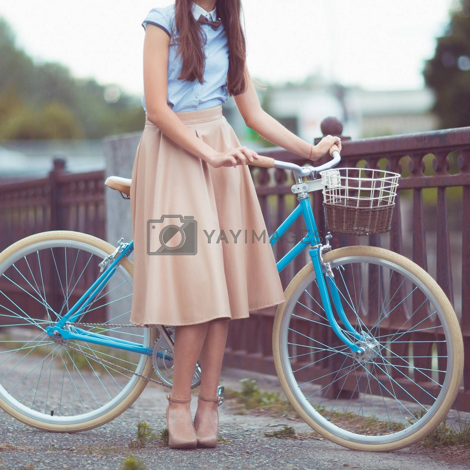 Royalty free image of Young beautiful, elegantly dressed woman with bicycle. Beauty, f by vlad_star