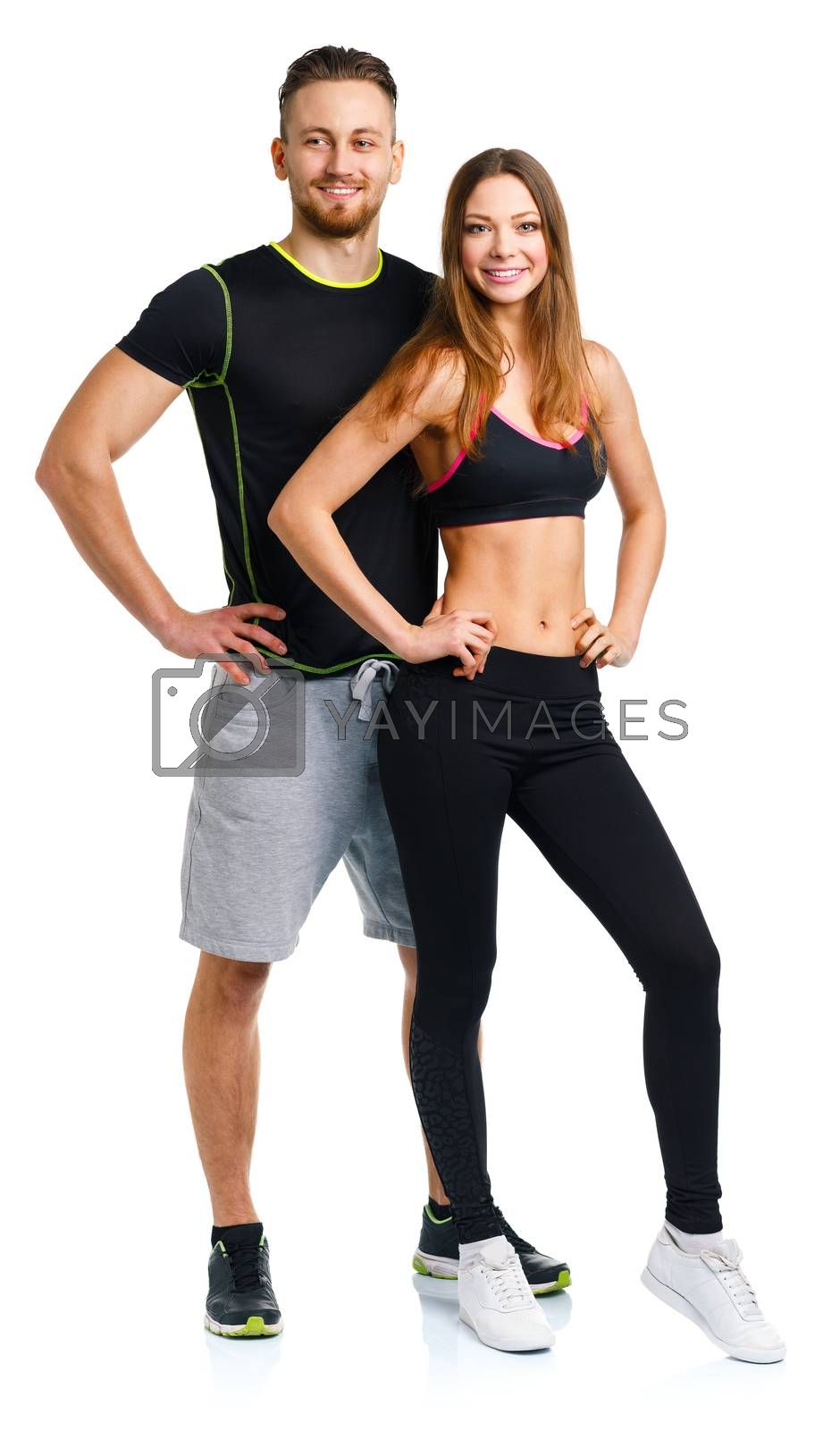 Royalty free image of Sport couple - man and woman after fitness exercise on the white by vlad_star