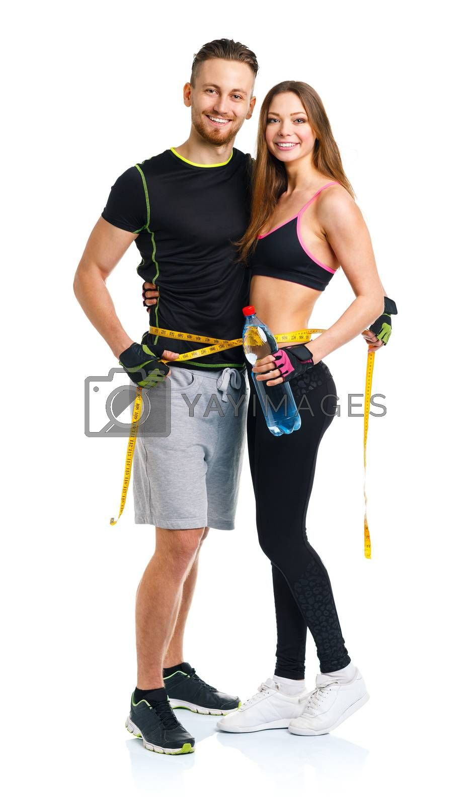 Royalty free image of Happy sport couple - man and woman with measuring tape on the wh by vlad_star