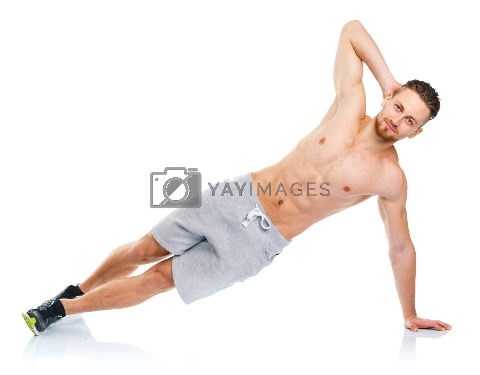 Royalty free image of Sport attractive man doing fitness exercises on the white by vlad_star