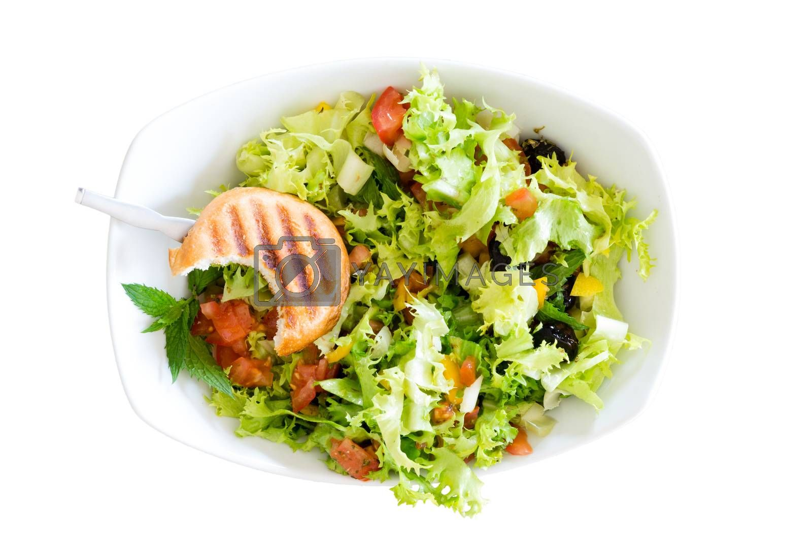 Royalty free image of Fresh salad with a bitten toasted bun by coskun