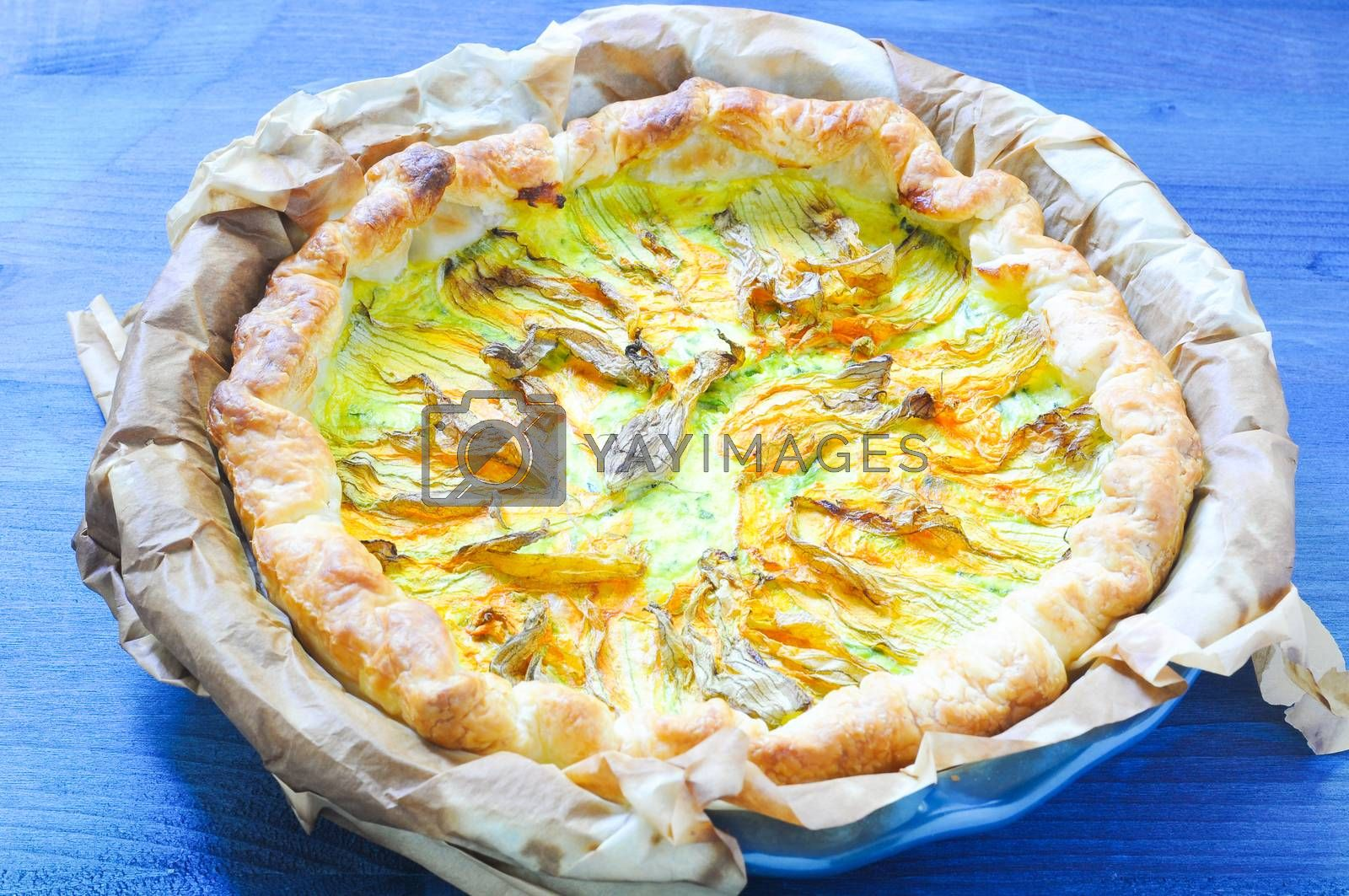 Royalty free image of Savory pie with ricotta, parmesan and zucchini flowers by gringox