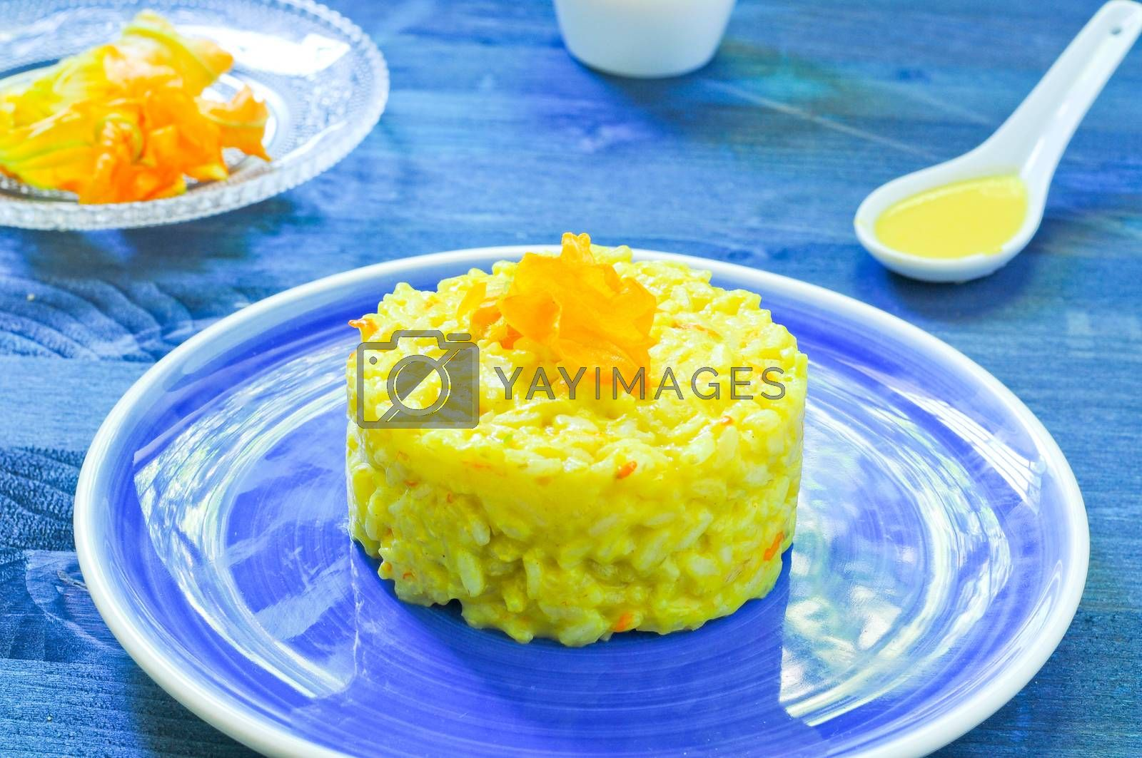 Royalty free image of Risotto with pumpkin flowers with saffron cream by gringox