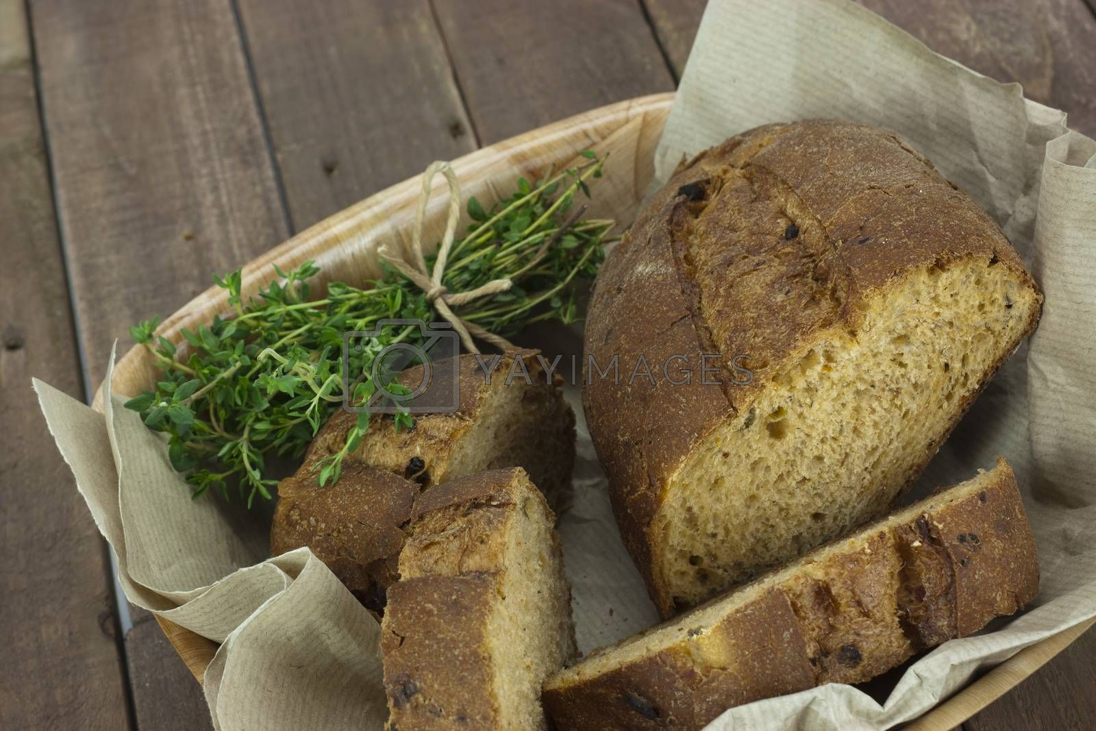 Loaf of bread in a basket by christopherhall