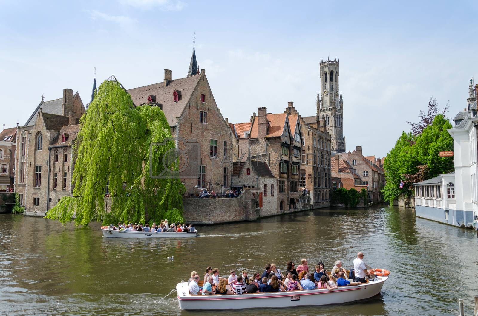 Royalty free image of Bruges, Belgium - May 11, 2015: Tourist visit Rozenhoedkaai in Bruges, Belgium by siraanamwong