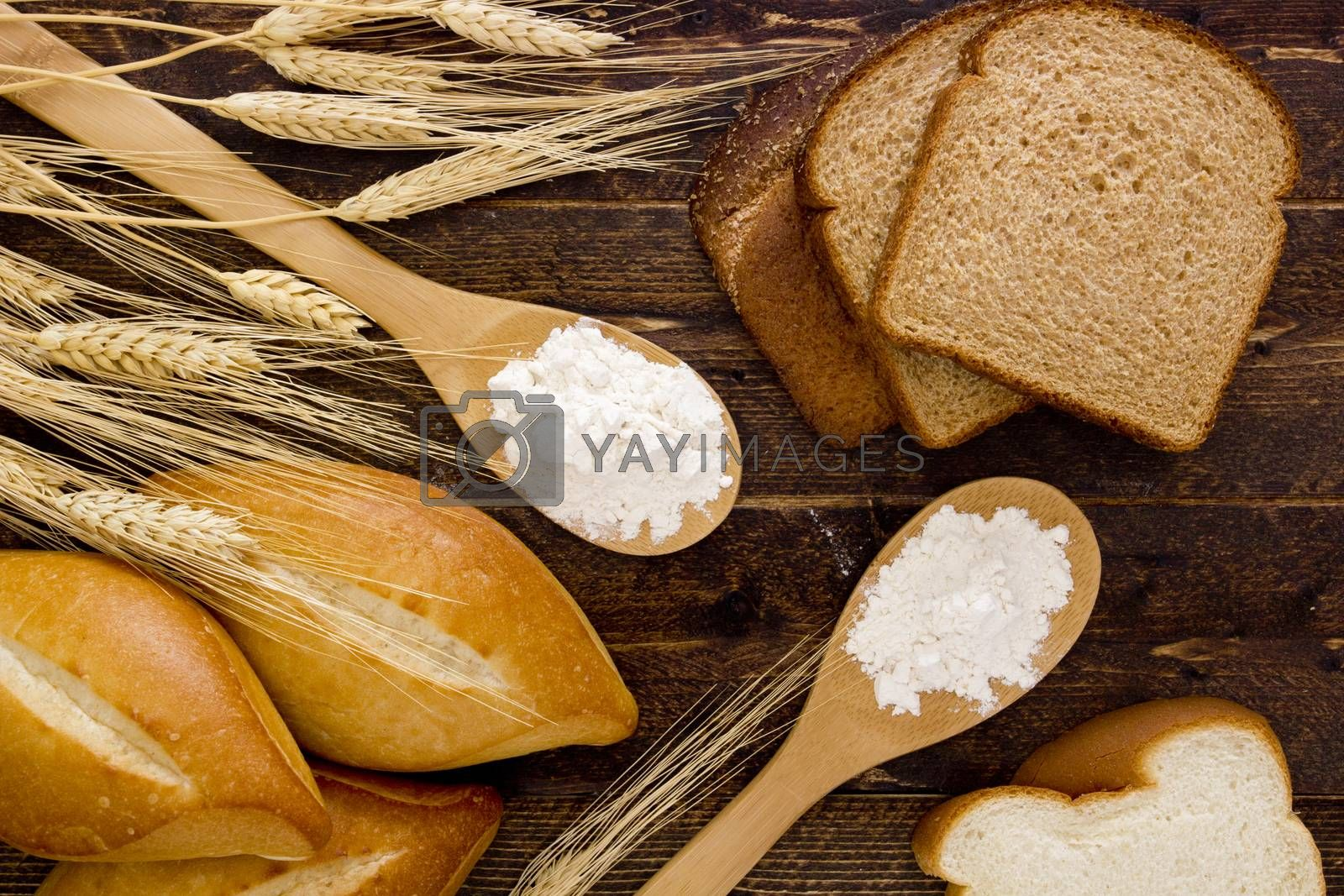 Royalty free image of Bakery products flour in a wooden spoon by VIPDesignUSA