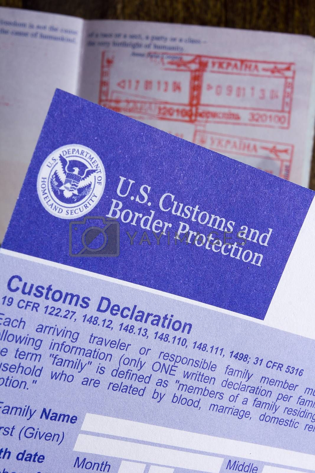 Royalty free image of Customs declaration and passport by VIPDesignUSA