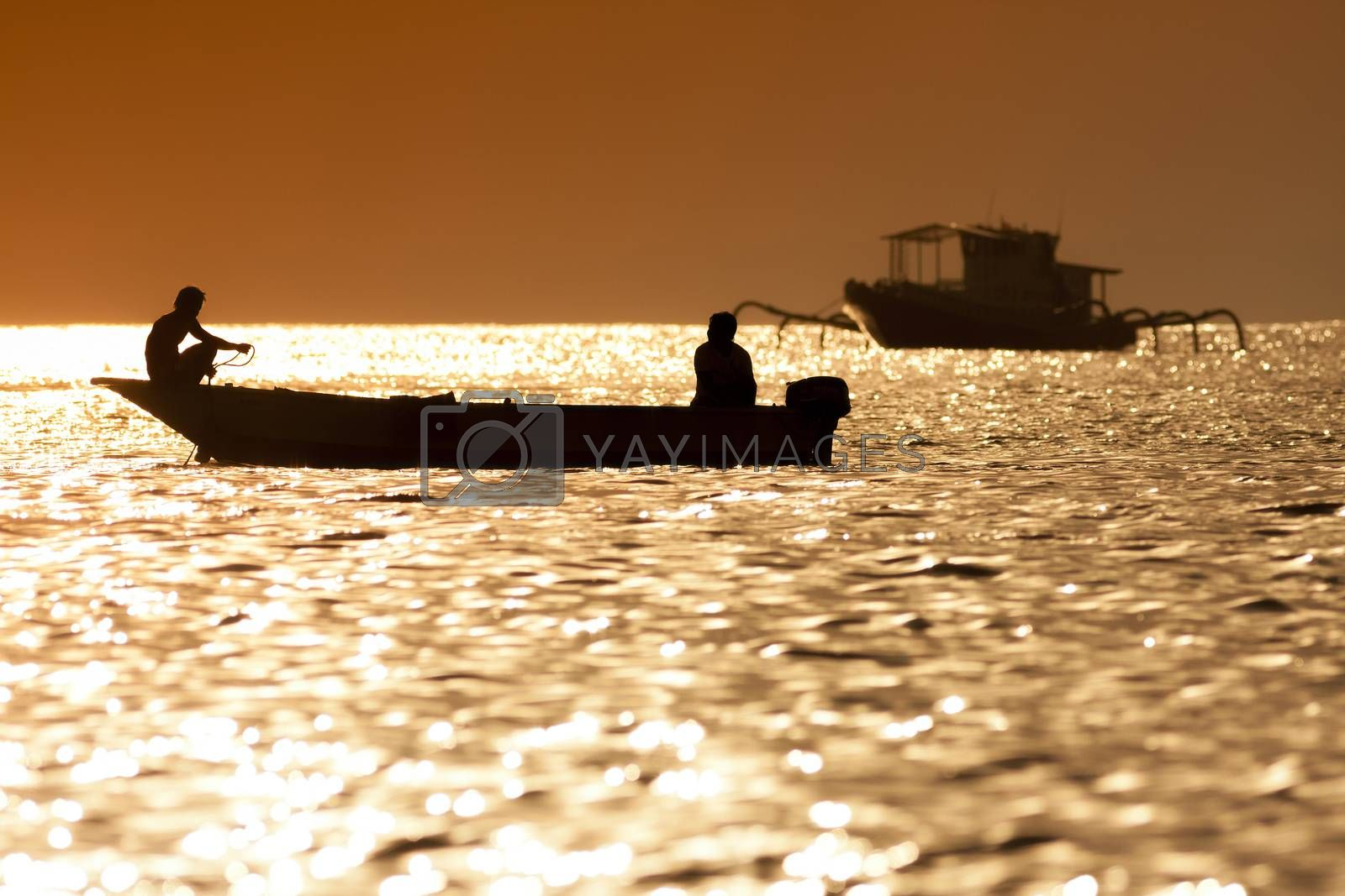 Royalty free image of Sunset scene of  fisherman boat by truphoto