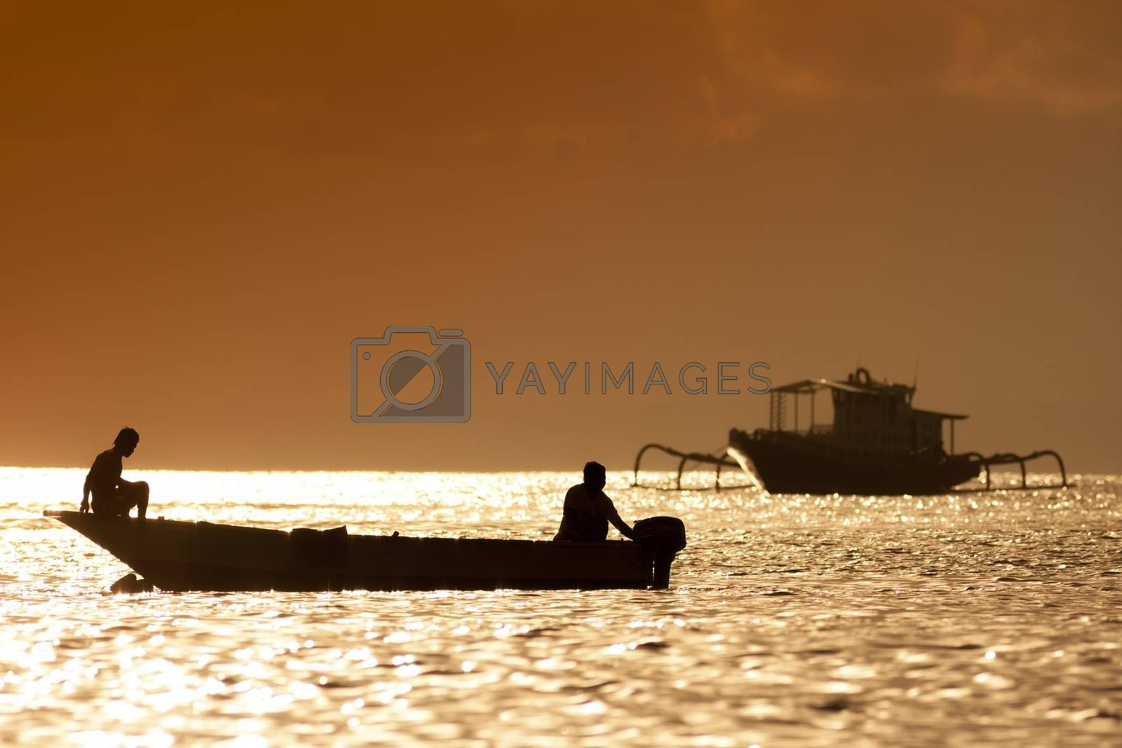 Sunset scene of  fisherman boat by truphoto