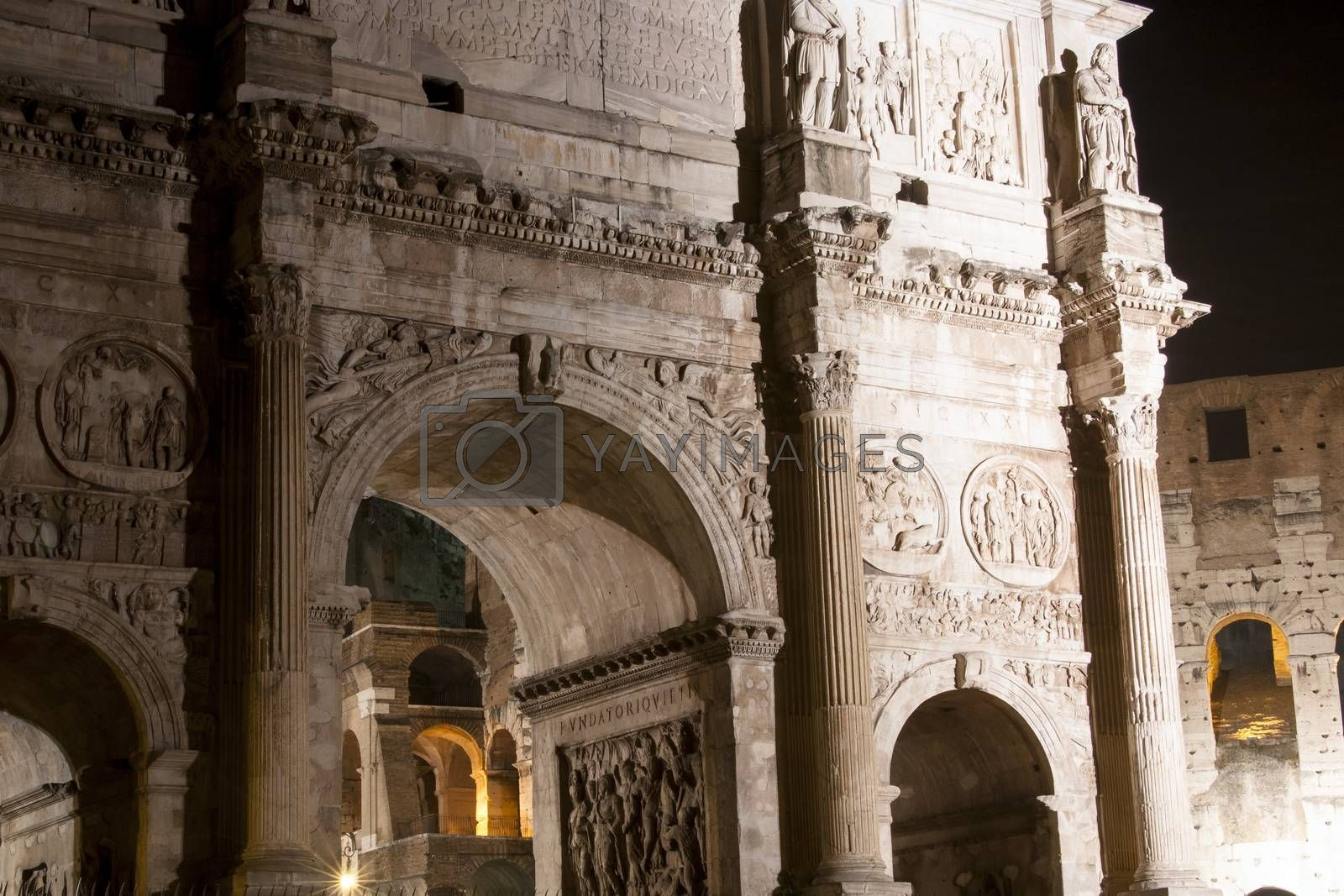 Royalty free image of Colosseum and Arch of Constantine at night by antonio.li