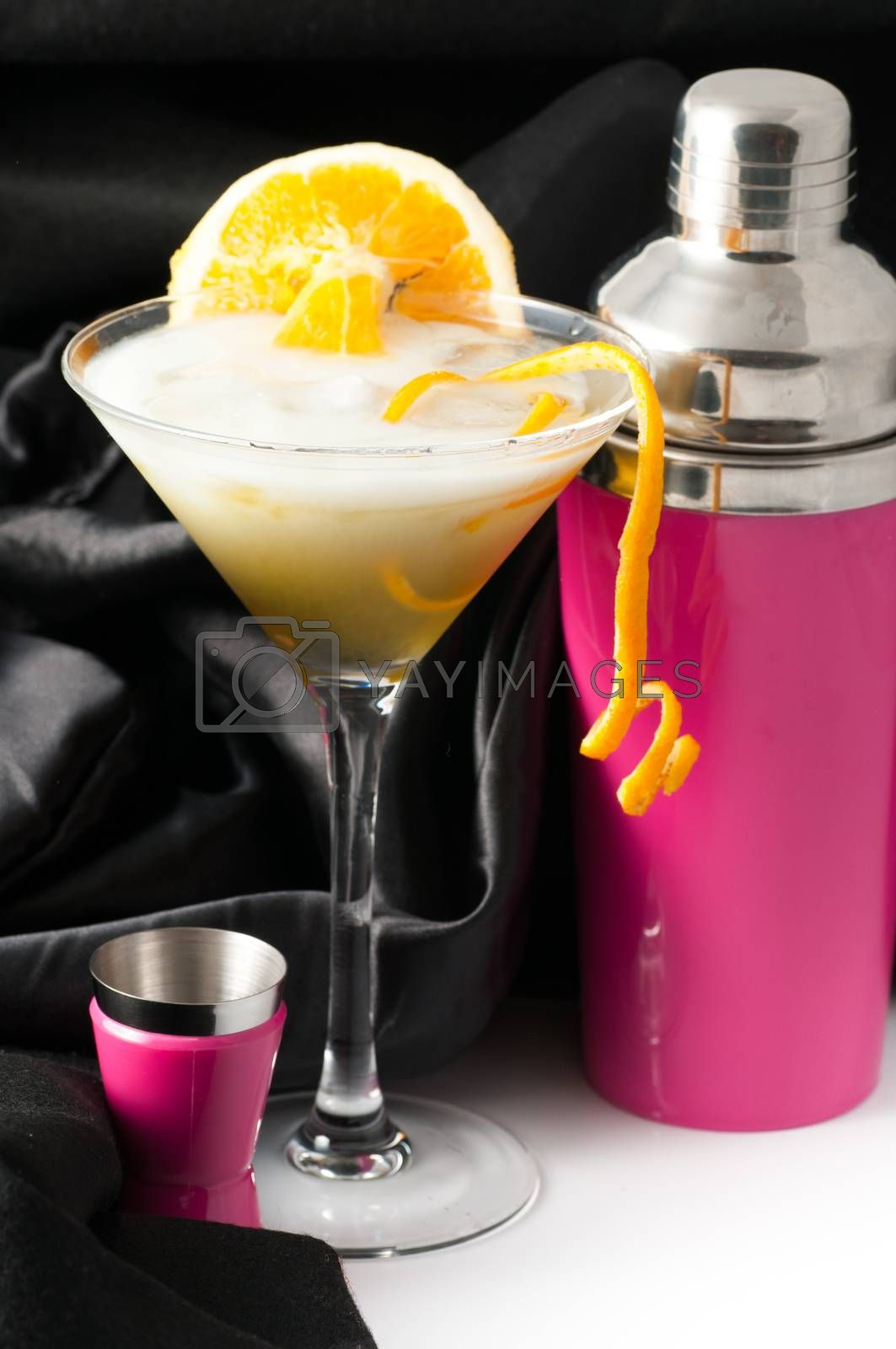 Royalty free image of orange with pink cocktail shaker by antonio.li