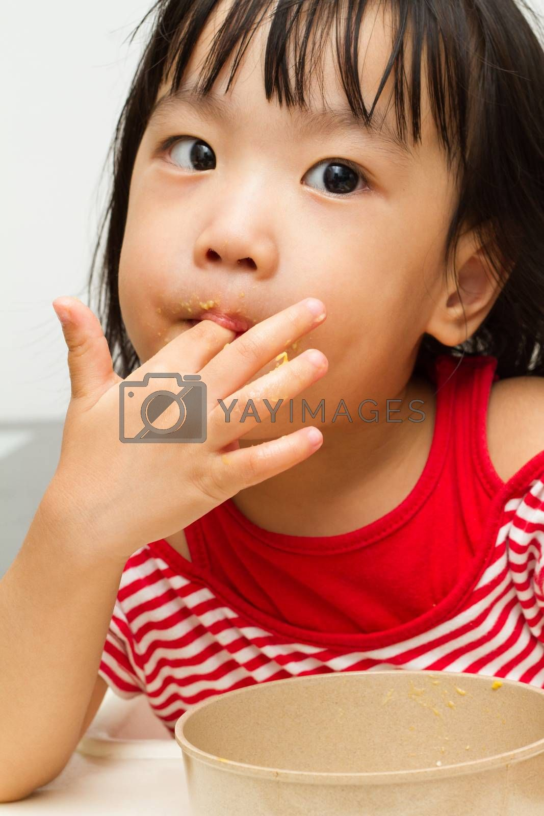 Royalty free image of Chinese Girl Eating Durian by kiankhoon