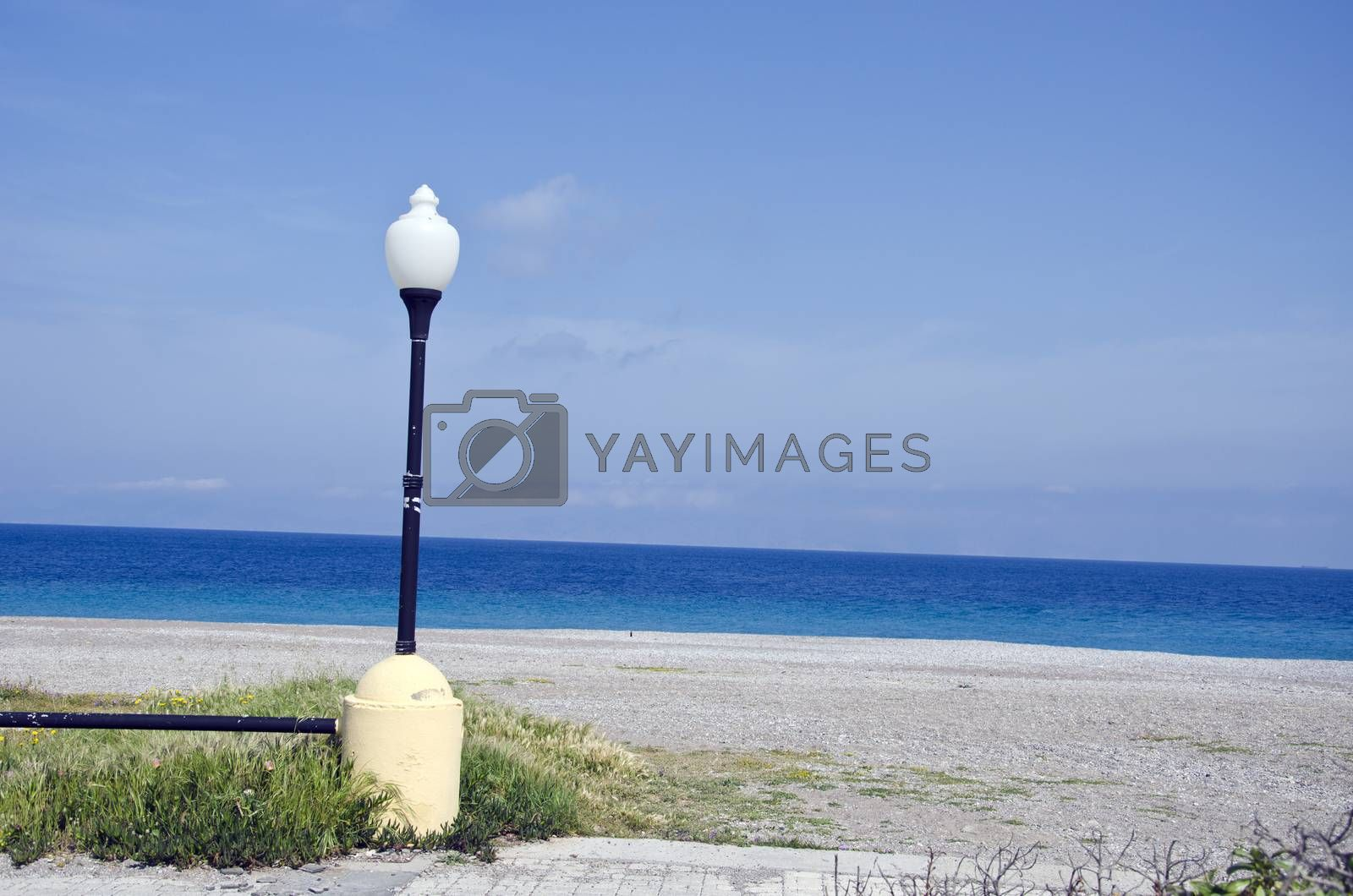 Royalty free image of beautiful resort beach with stone in Rhodes island by alis_photo