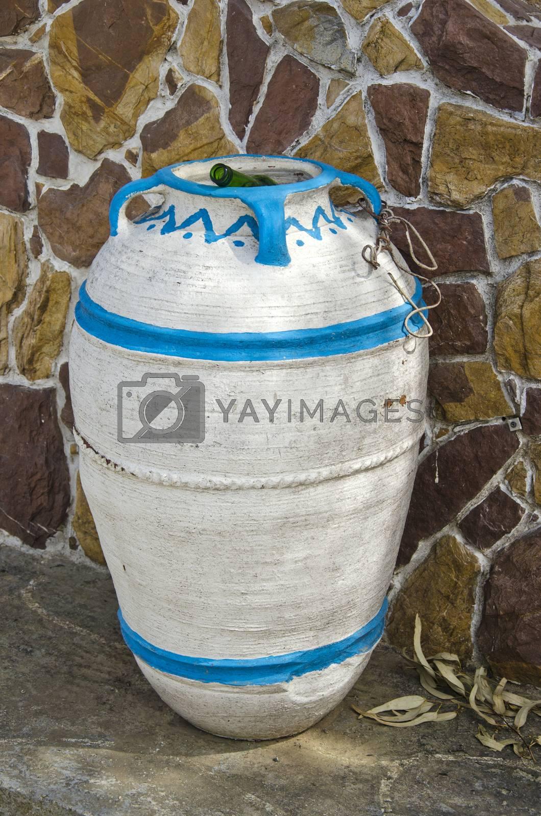 Royalty free image of amphora form dust bin in street, Greece by alis_photo