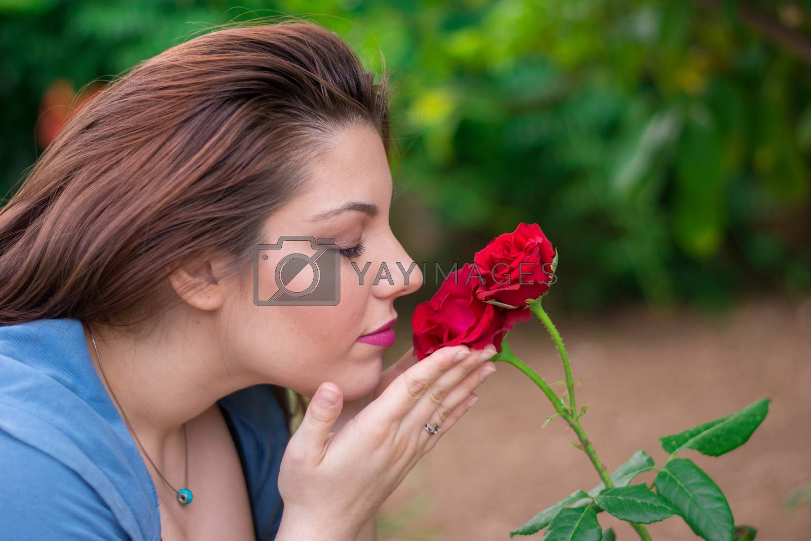 Royalty free image of Smelling the roses by ValEs1989