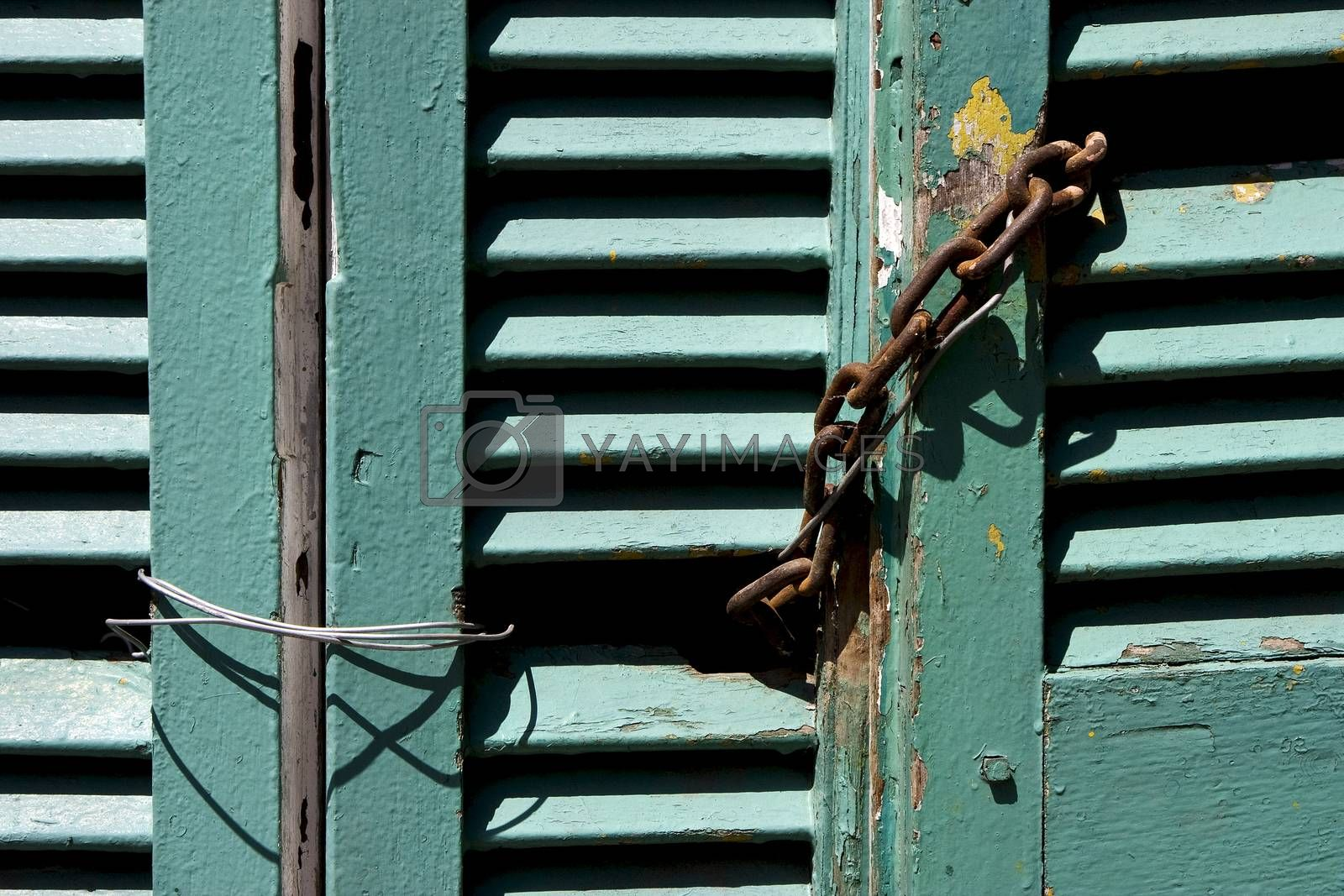 Royalty free image of venetian blind and a rusty chain in la boca  by lkpro