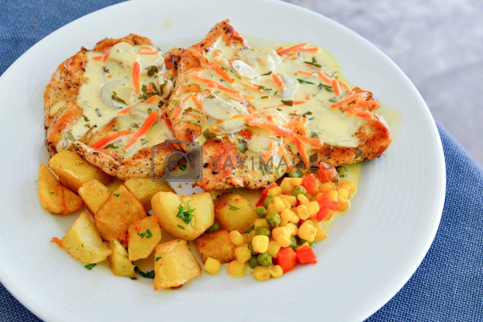 Royalty free image of Grilled garnish chicken steaks by nehru