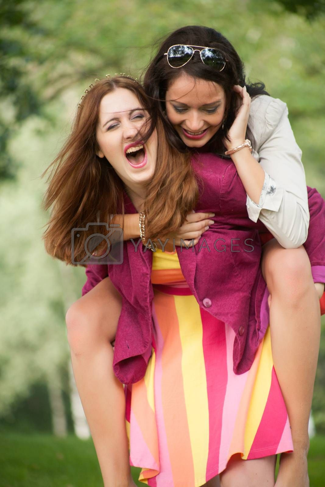 Two girls are having a lot of fun in the forest