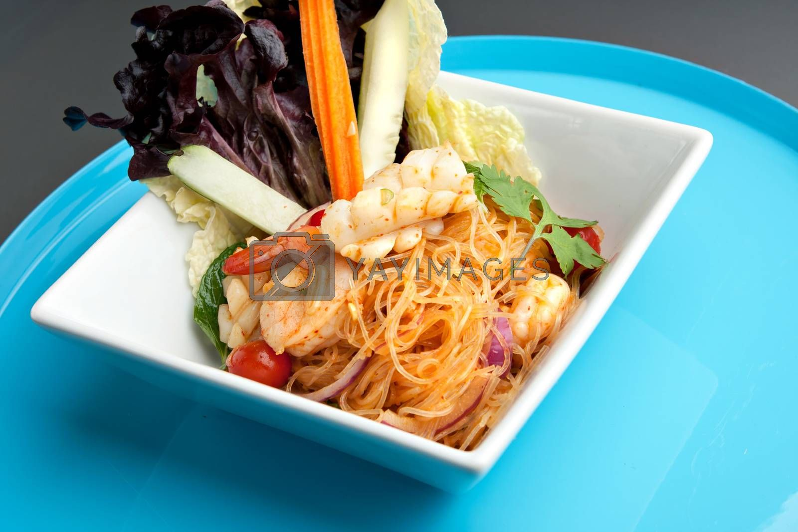 Thailand style shrimp and seafood salad with veggies.