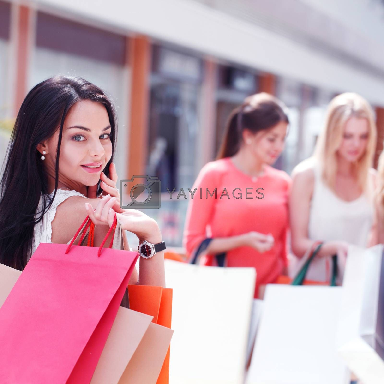 Women shopping in mall by ALotOfPeople