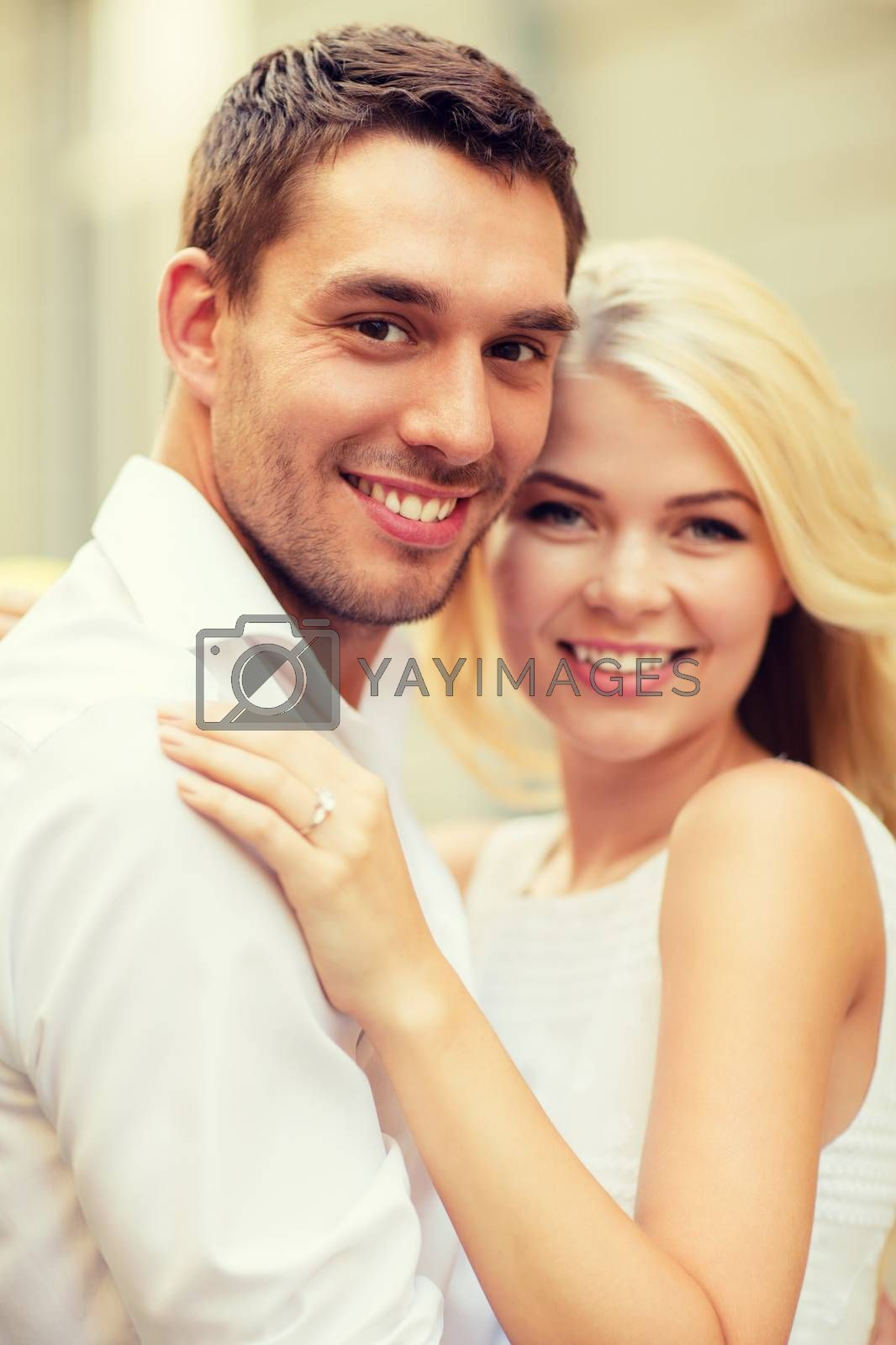 summer holidays, celebration and wedding concept - young engaged couple in the city