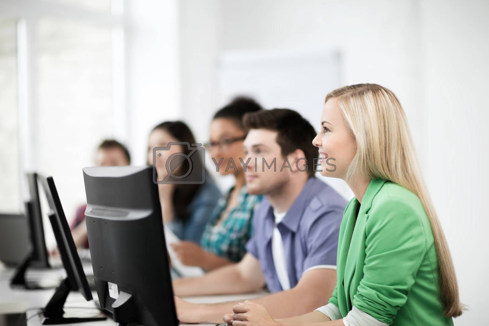 education, technology and internet - students with computers studying at school